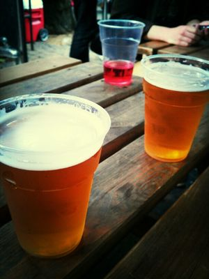 drinking beer at Brick Lane Market by Ruth Vakrat Fogel