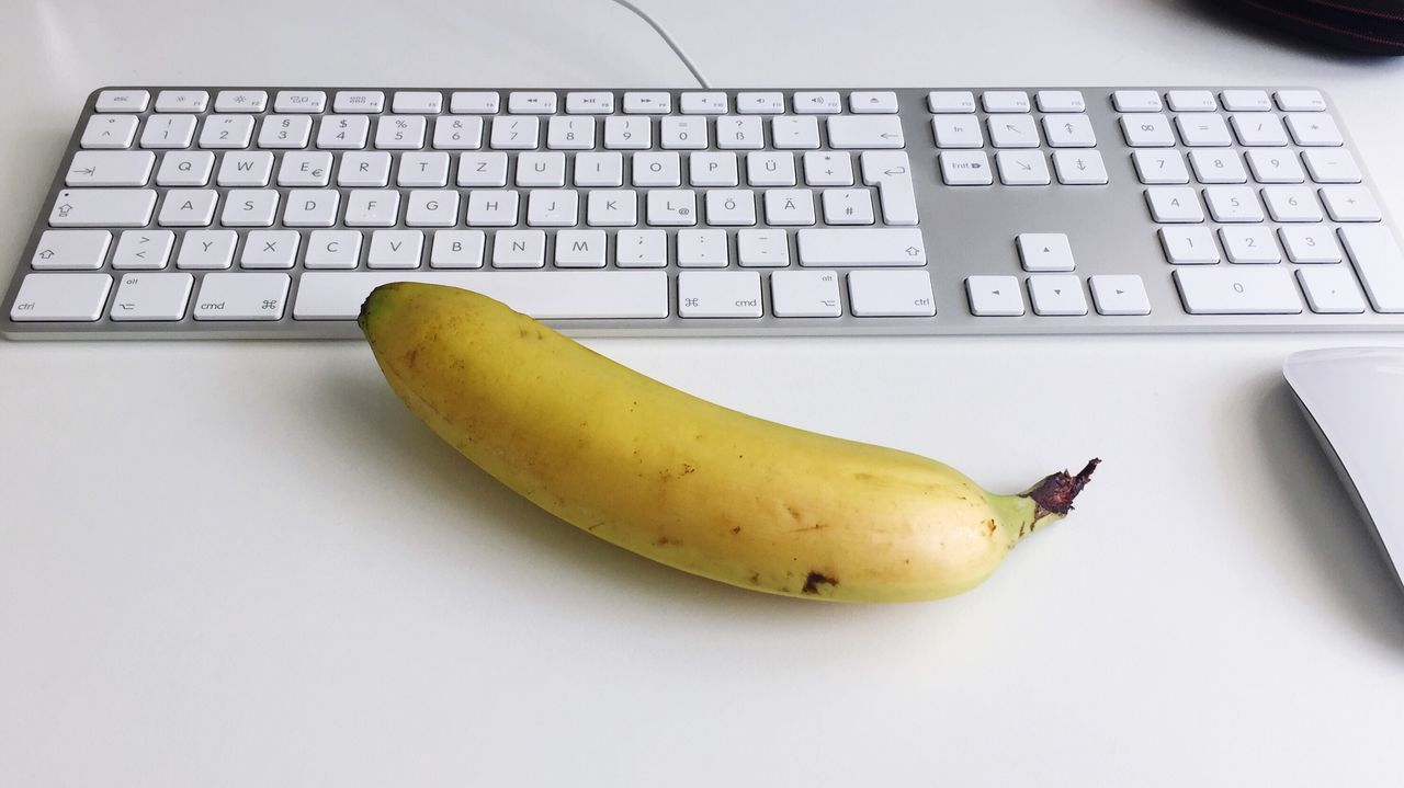 Technology Computer Keyboard Banana Fruit Food And Drink Laptop Desk Food Indoors  Office High Angle View Computer Yellow Wireless Technology Healthy Eating No People Close-up Keyboard Computer Key Day