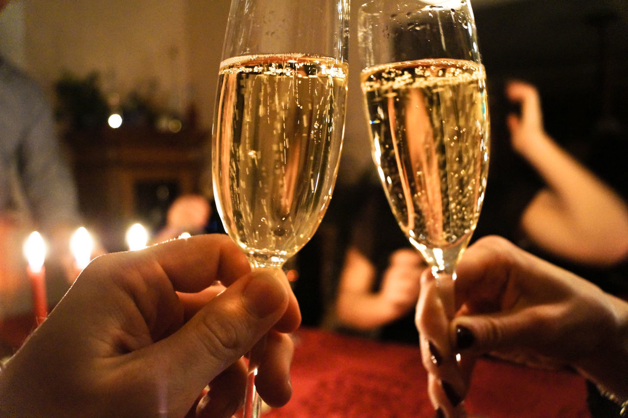 Cropped Hands Of People Toasting Champagne In Party