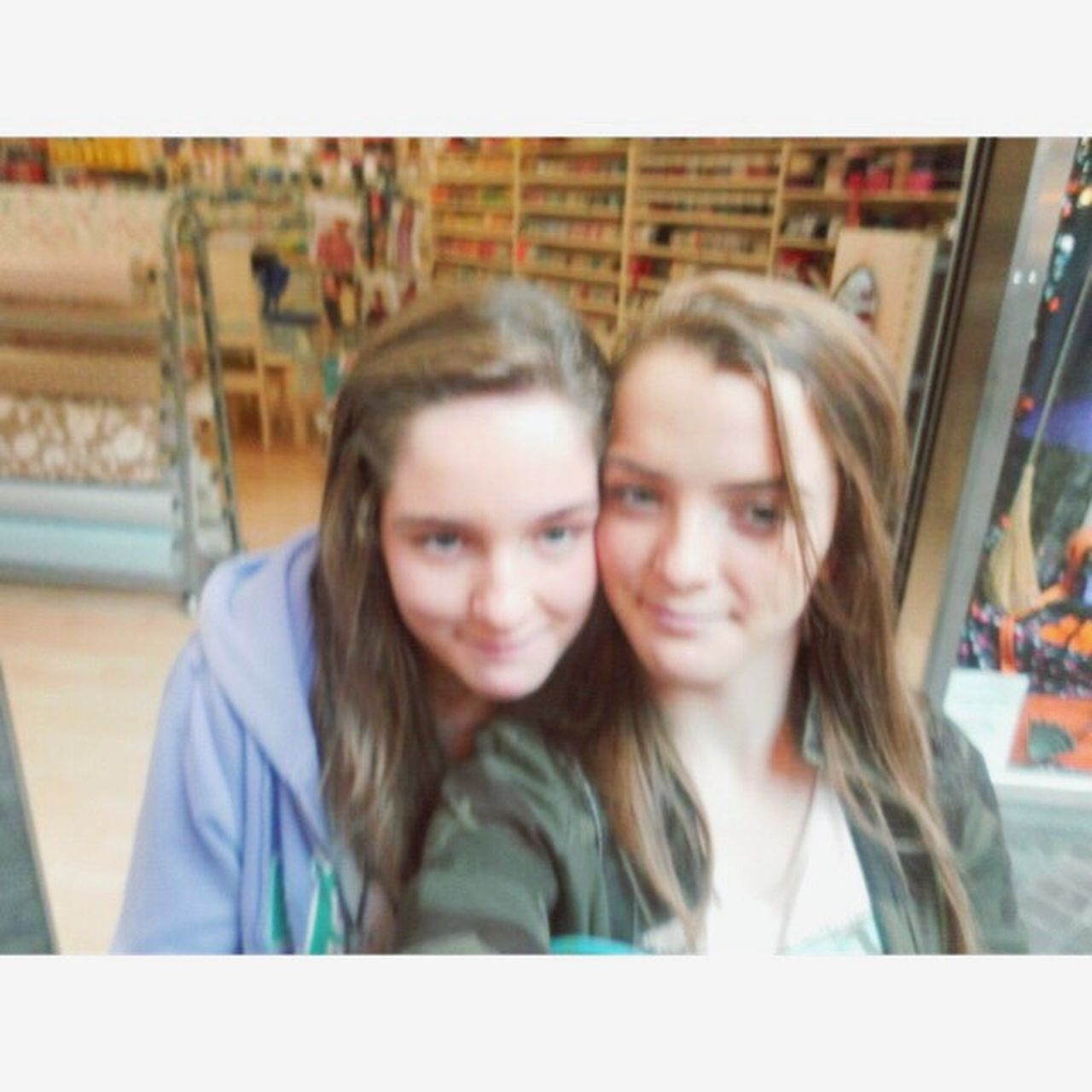 two people, togetherness, front view, smiling, blond hair, day, young adult, looking at camera, friendship, portrait, sitting, headshot, indoors, happiness, young women, people, adult, close-up, adults only