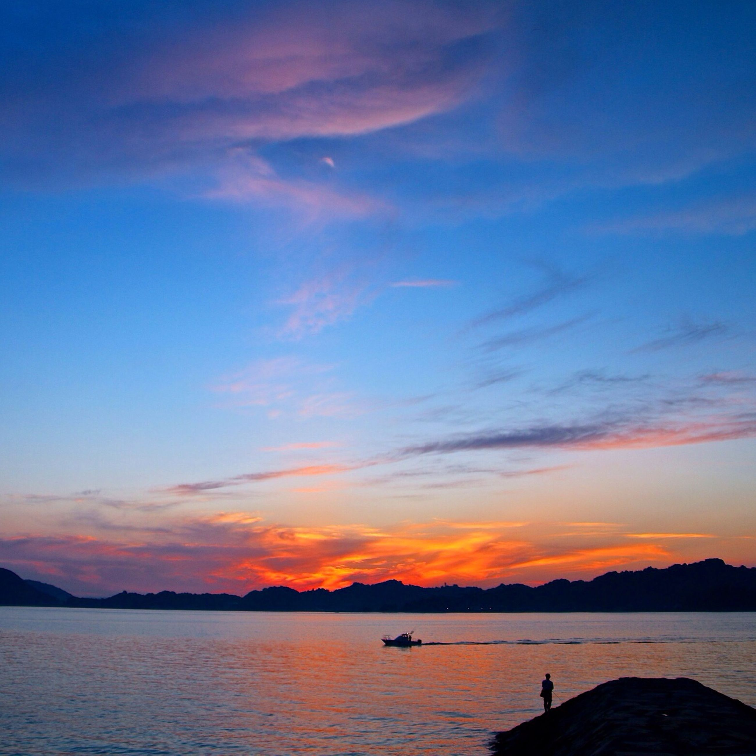 sunset, water, scenics, tranquil scene, sky, tranquility, silhouette, beauty in nature, sea, mountain, waterfront, orange color, idyllic, nature, cloud, cloud - sky, rippled, blue, outdoors, lake