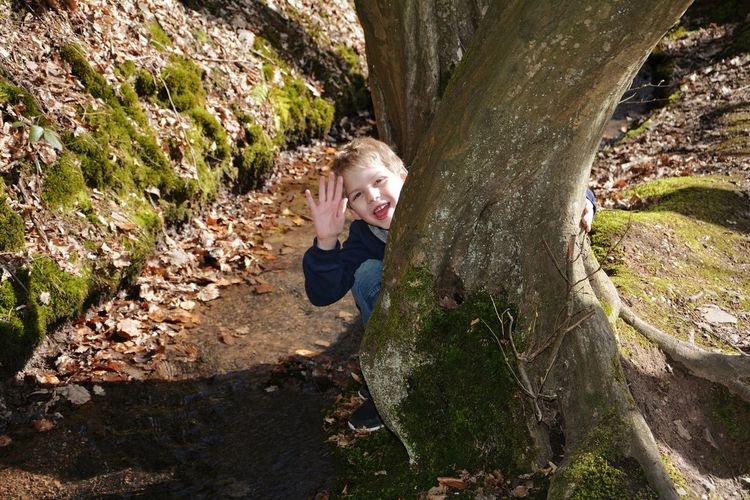 Hello friends....👍😃 One Person Outdoors Blond Hair Nature Sitting People Portrait Laughs Winks Winks* Boy Childhood Child Tree Tree Trunk Tree_collection  Tree Bark Stream Water River Autumn🍁🍁🍁