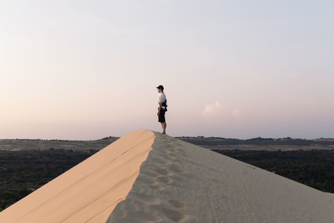 Adventure Beauty In Nature Desert Mui Ne Nature One Person Outdoors People Real People Sand Sand Dune Sky Sunset Travel Travel Destinations Travel Photography Vietnam Live For The Story