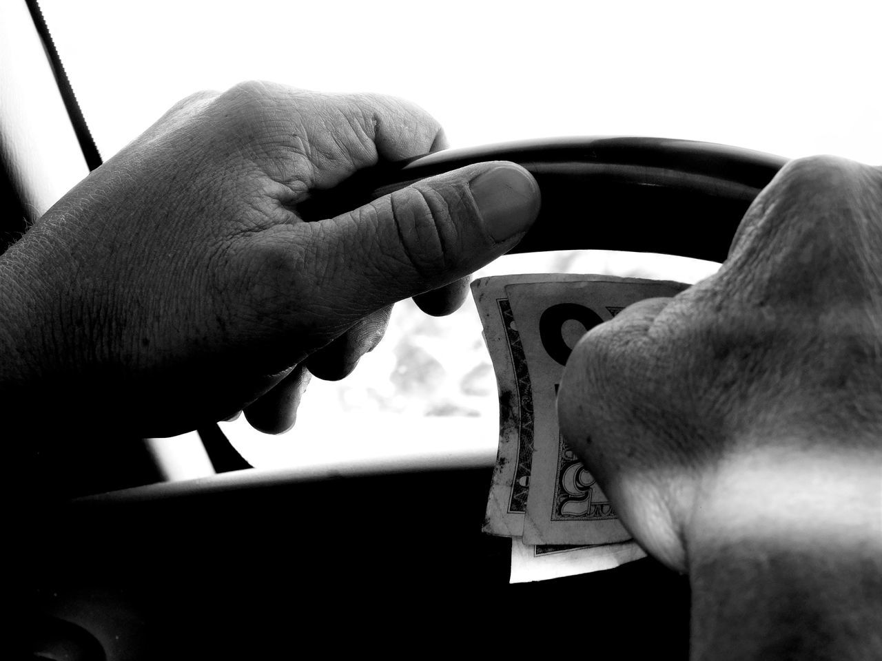 Monochrome Photography Blackandwhite Darkness And Light Money Dollars On The Road Driving Steering Wheel Hands Light And Shadow Life Is A Journey Notes From The Underground Random Acts Of Photography Lifestyles Florida Floridaphotographer Minimalism Untold Stories Maximum Closeness The Drive Cash