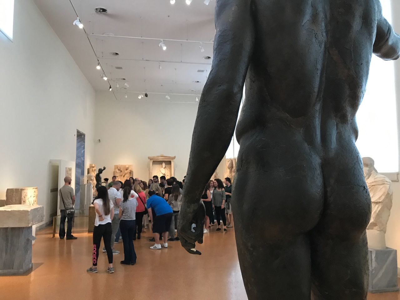 Indoors  Standing Men Real People Rear View Women Lifestyles Large Group Of People Togetherness Day People