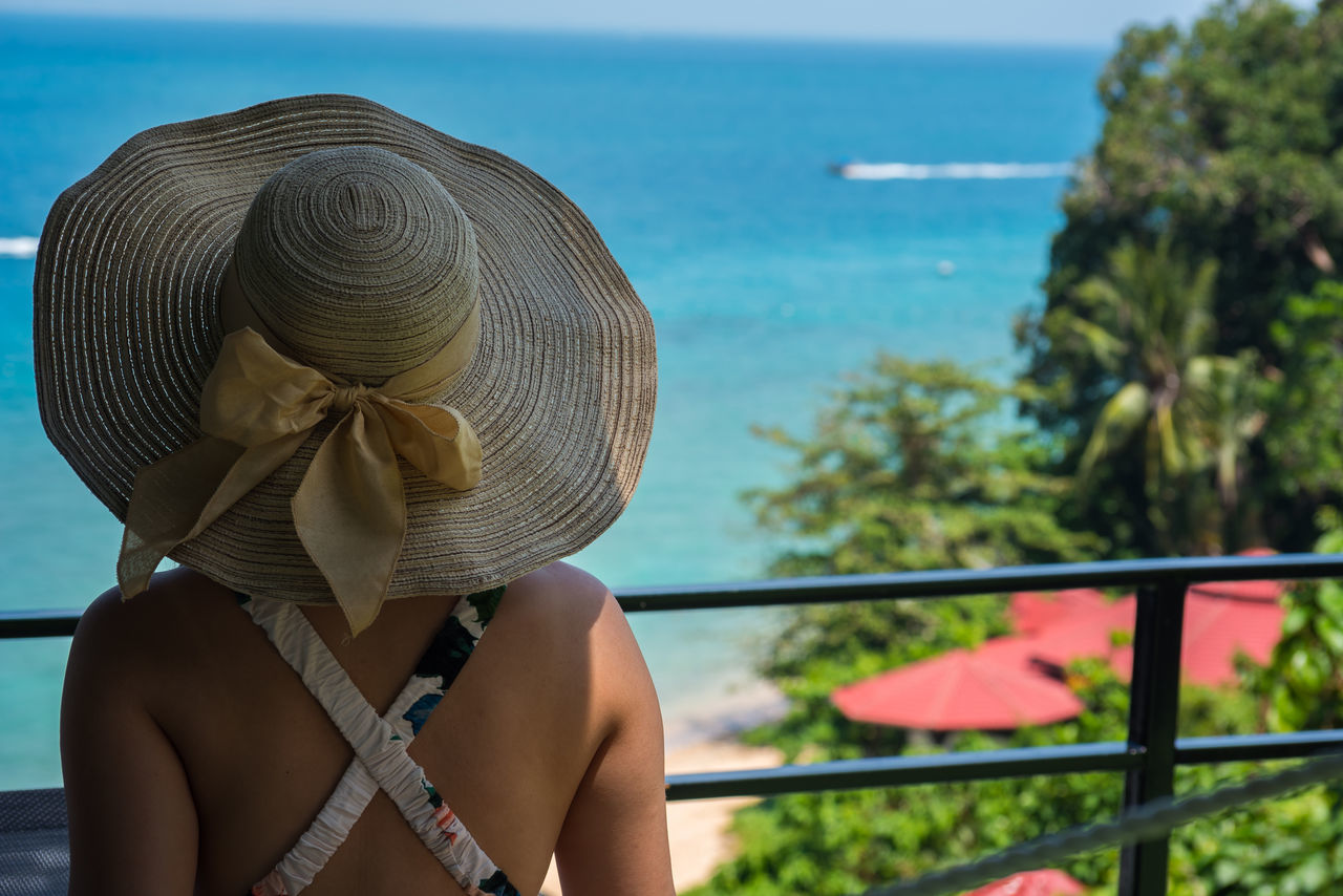 Girl enjoying the view of beautiful sea. Adult Adults Only Beach Close-up Day Hat Headshot Holiday Nature One Person One Woman Only Only Women Outdoors People Rear View Sea Sea And Sky Sun Hat Travel Vacations Water Women Young Adult