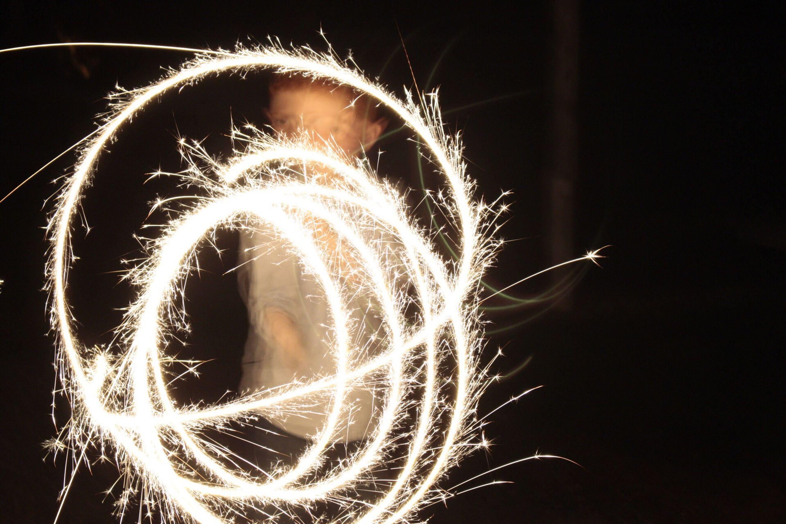 long exposure, motion, sparks, night, celebration, glowing, firework - man made object, firework display, sparkler, illuminated, no people, arts culture and entertainment, wire wool, close-up, outdoors