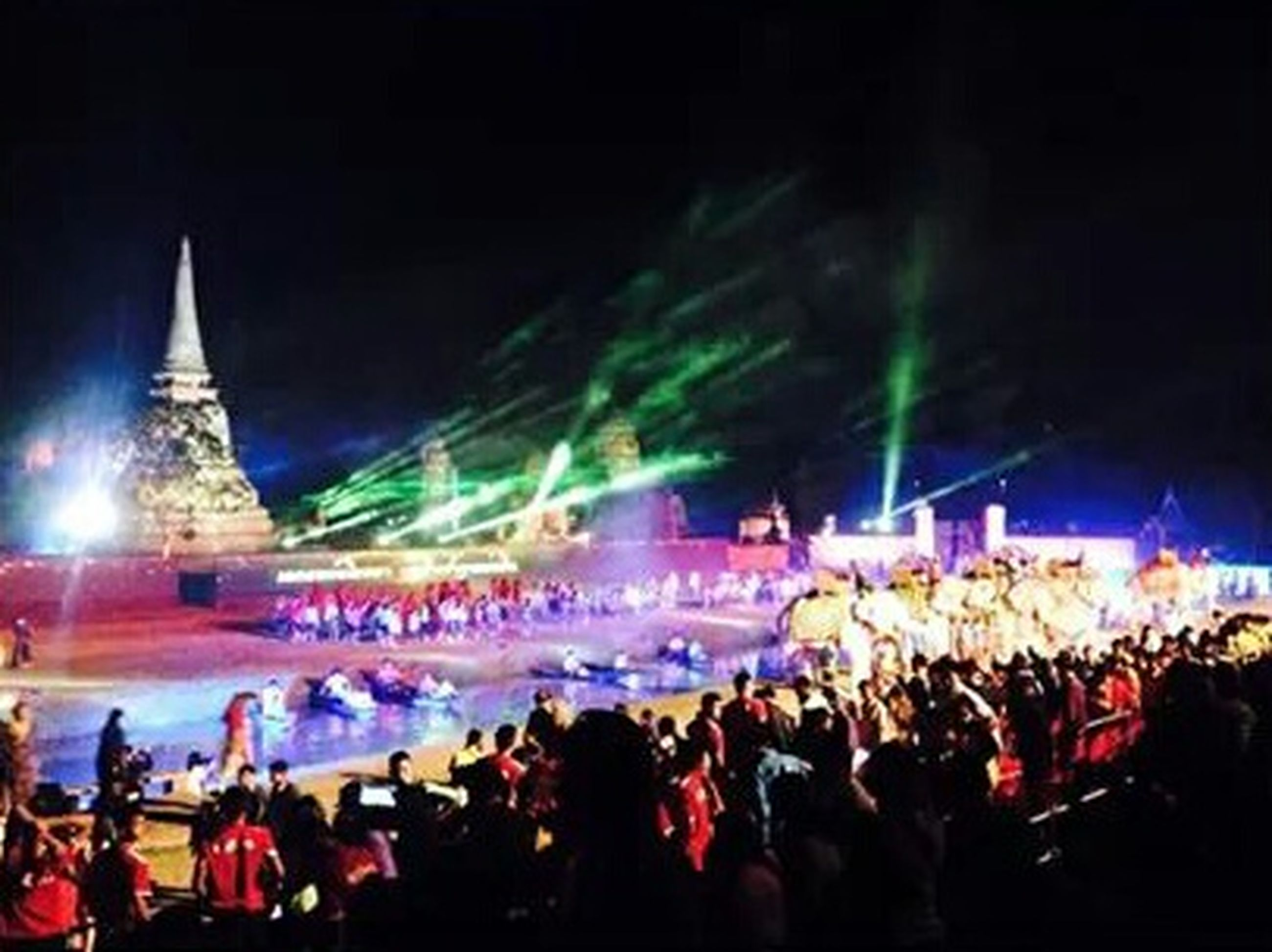 large group of people, crowd, illuminated, lifestyles, men, person, night, leisure activity, enjoyment, celebration, event, arts culture and entertainment, performance, music, mixed age range, concert, stage - performance space, spectator