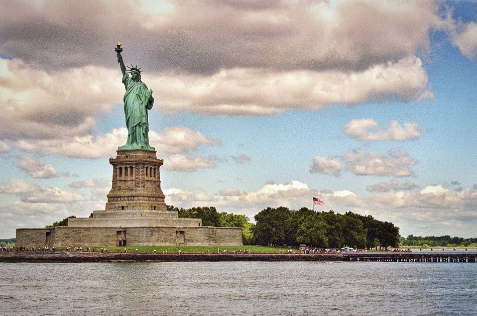 Lady Liberty in all her splendour. Statue Of Liberty Travel Destinations New York Liberty Island Travel Photography Vacations Statue Sculpture Tourism Famous Place Statue Of Liberty Monument Built Structure Film Photography 35mm Film New York City Filmisnotdead Film Battle Of The Cities