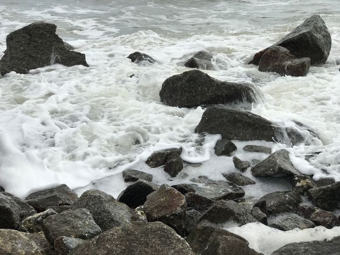 Sea Motion Nature Rock - Object Shore Water Wave Beach No People Beauty In Nature Outdoors Day Pebble Beach Swirl Tide Tide Pool Sea Wall Ocean White Water