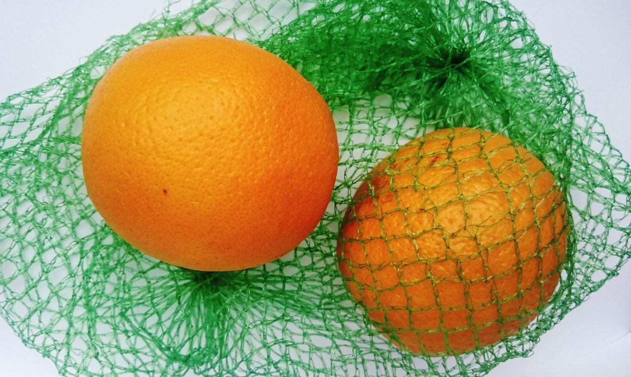 Inside and Outside Oranges Caught in the Web like Fishes Power of People on this Earth Catching Chasing Constrain everything and Everybody they want Posessed Own WEBS Fences The Human Condition Desires Longing Demands Eagerness where are the Boundaries Simplicity Minimalism