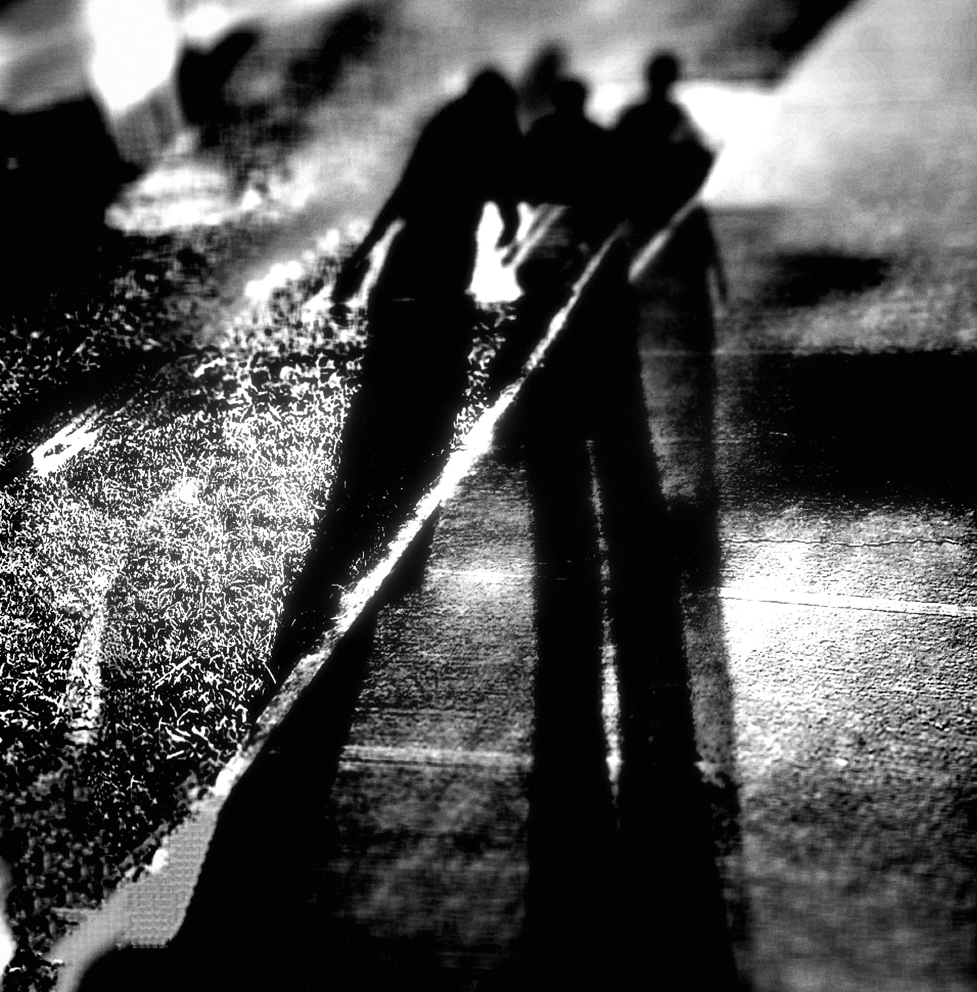 shadow, lifestyles, silhouette, leisure activity, focus on shadow, men, person, sunlight, standing, unrecognizable person, togetherness, outline, walking, bonding, street, low section, outdoors