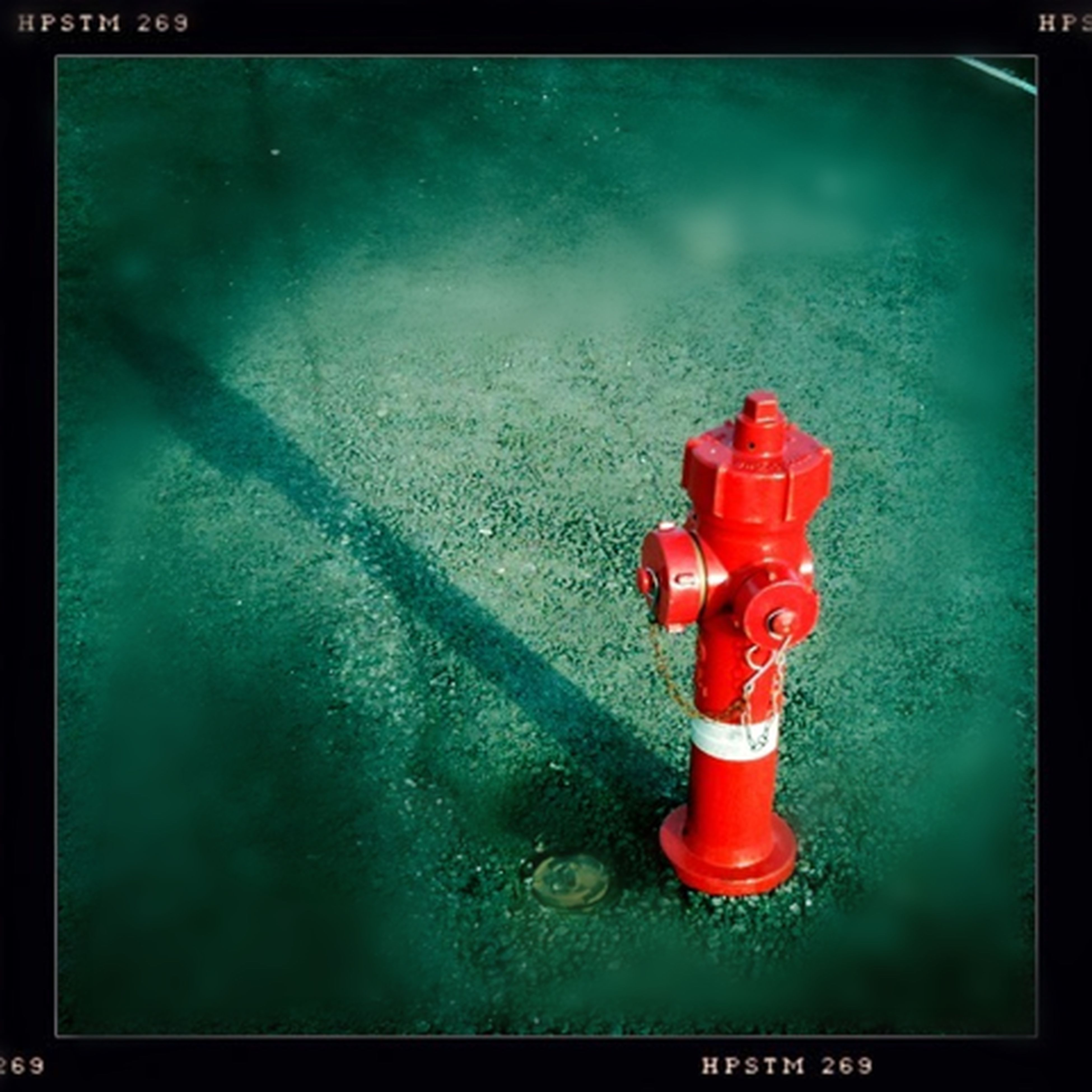 transfer print, red, auto post production filter, safety, metal, security, protection, close-up, high angle view, guidance, blue, no people, wall - building feature, single object, metallic, technology, outdoors, fire hydrant, lock, day