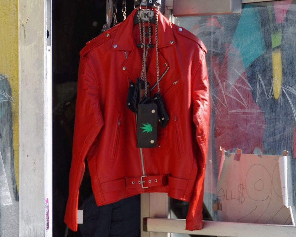 80's 😂 Retail  Bag Clothing Hanging Clothing Store For Sale Day Outdoors Store Fashion One Person Purse Coathanger Real People Standing Close-up People Leather Jacket From Where I Stand Walking Around The City  Streetphotography New York City