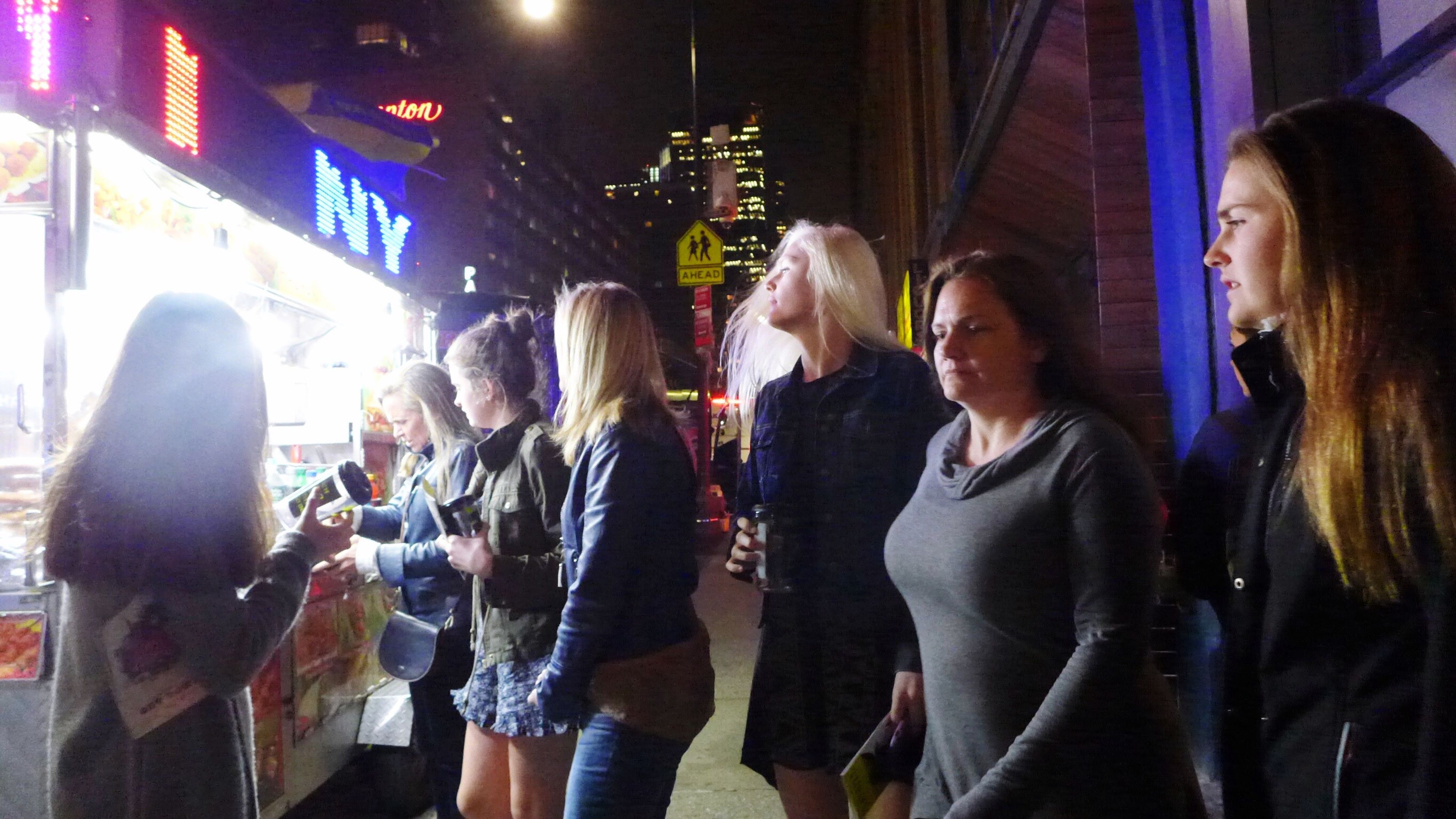 night, illuminated, large group of people, enjoyment, crowd, real people, young women, standing, togetherness, men, young adult, women, happiness, indoors, people, adult, adults only, city