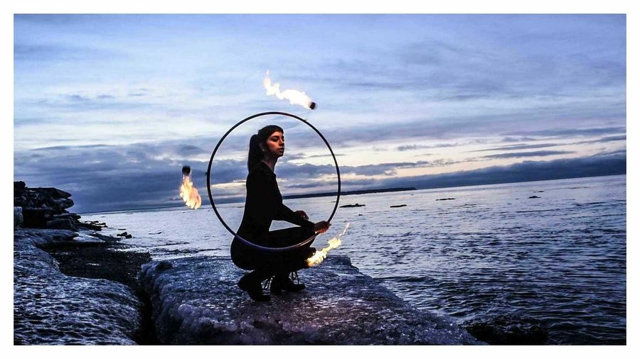 Fire & Ice in Alaska. Silouette Lightroom Nikon Modelingposes Portraitmood Woman Hooping  Artisticphotography 2018mood Aesthetic Profileportrait Sea Beach One Person Water Outdoors Full Length People Horizon Over Water Real People Nature Sky