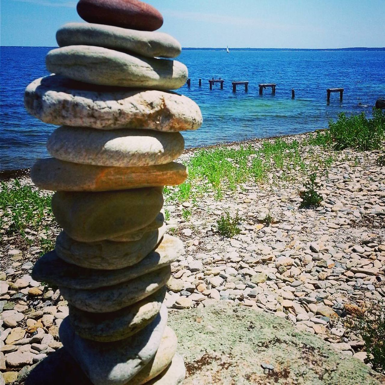 balance, sea, water, stack, rock - object, horizon over water, nature, pebble, tranquil scene, no people, day, tranquility, outdoors, beauty in nature, scenics, clear sky, sky, close-up