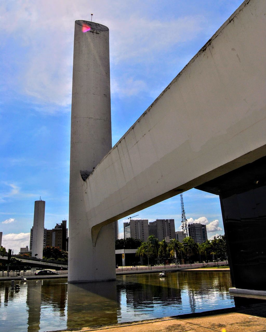 architecture, built structure, bridge - man made structure, water, connection, building exterior, day, river, architectural column, sky, waterfront, no people, sunlight, outdoors, low angle view, city, travel destinations, nature