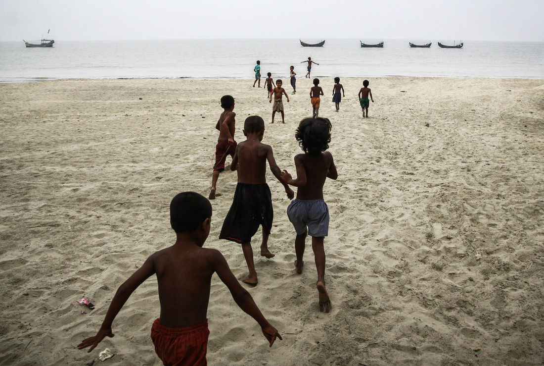 Children of heaven Beach Beachboys Boys Childernplay Children On The Beach Horizon Over Water Leisure Activity Lifestyles Men Nature Person Rear View Sand Scenics Sea Shore Togetherness Tranquility Travel Vacations Water Weekend Activities