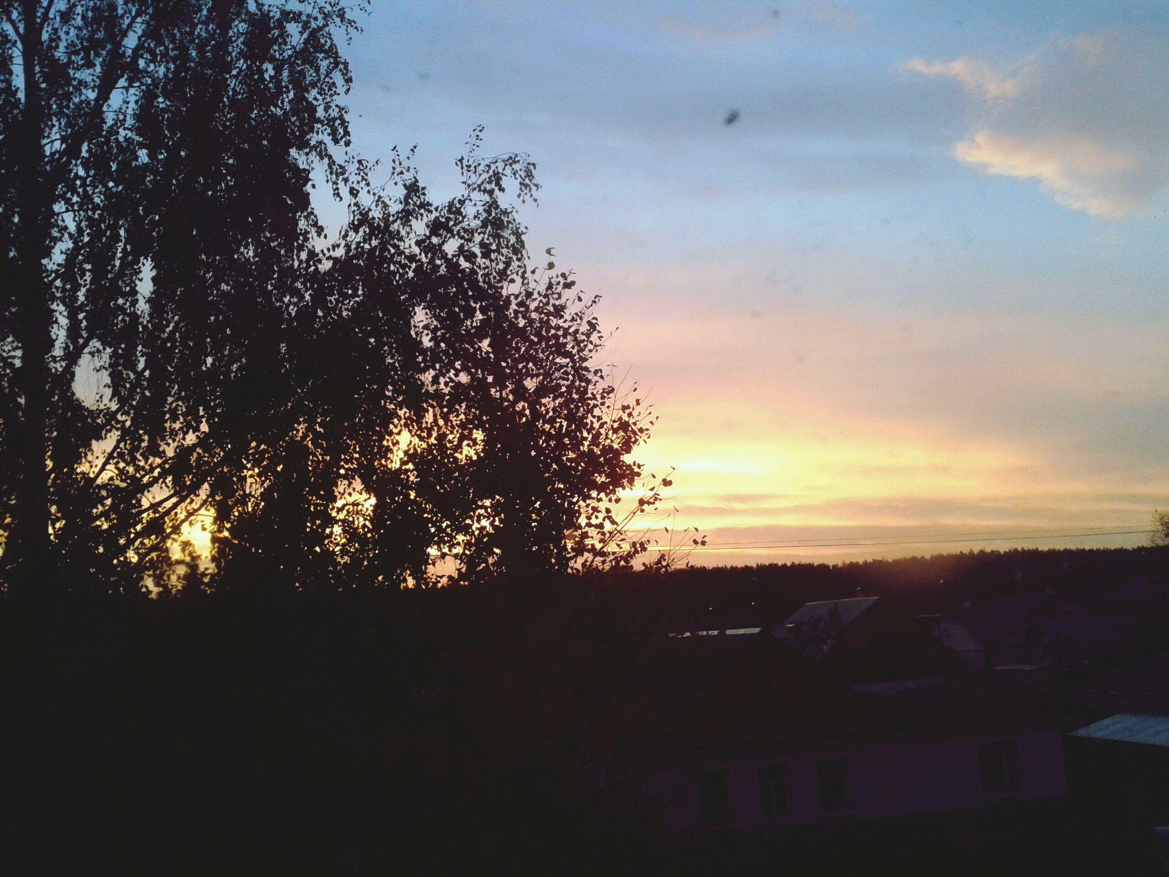 sunset, silhouette, sky, tree, scenics, beauty in nature, orange color, tranquil scene, tranquility, cloud - sky, nature, landscape, idyllic, cloud, outdoors, no people, dusk, built structure, building exterior, sunlight