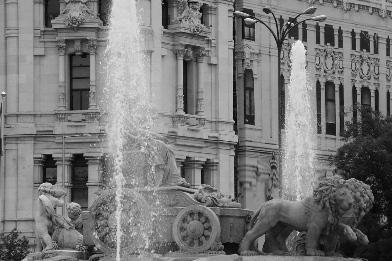 Building Exterior Architecture Built Structure Statue Outdoors Sculpture Day Men City Real People Water People Lions Plaza Cibeles Madrid Street Blackandwhite Check This Out Enjoying Life Hanging Out Black And White EyeEm Best Shots Taking Photos Travel Destinations City