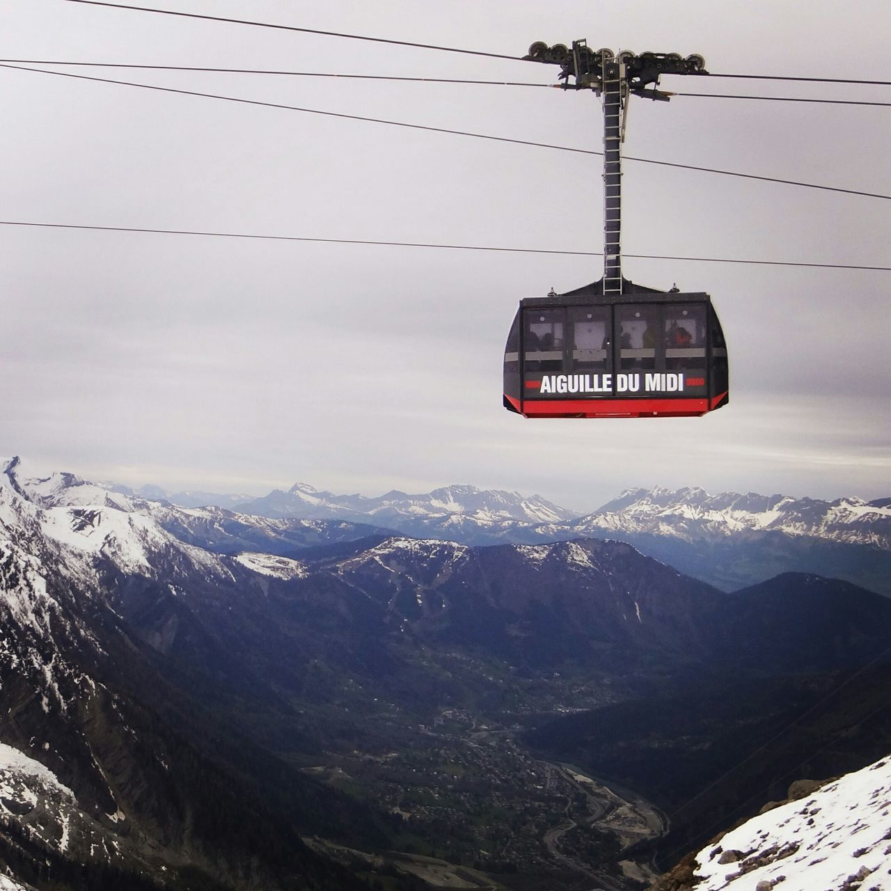 mountain, cable, mountain range, nature, sky, snow, cold temperature, scenics, overhead cable car, beauty in nature, power line, winter, weather, transportation, cloud - sky, landscape, tranquil scene, day, hanging, electricity, snowcapped mountain, tranquility, outdoors, no people, ski lift