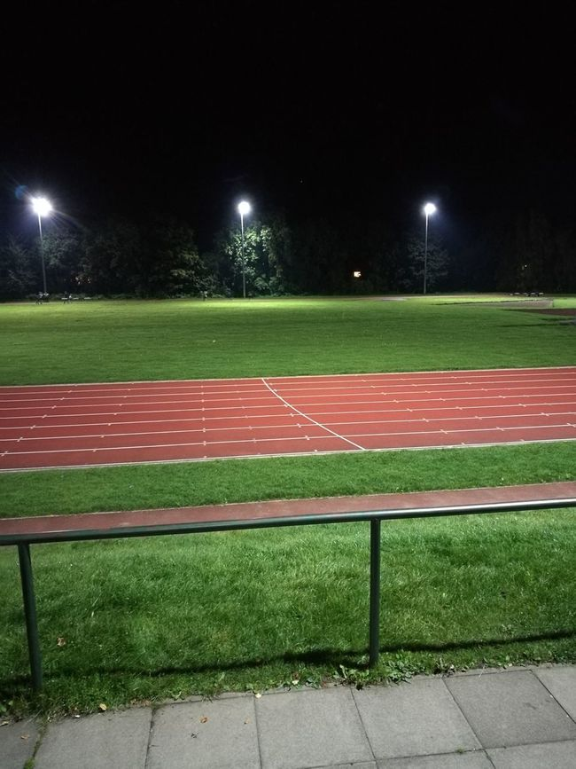 Stadium Night Sport No People Grass Illuminated Floodlight Outdoors Sky Sports Track Trees Tree Lifestyles Green Landscape Nature Full Length Athletics DarkRunning Running Track Track Sports Photography Empty Light