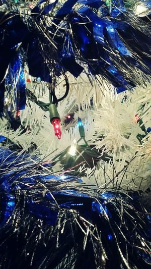 Christmas Tree Christmas Lights Christmas Decoration Yuletideseason Yuletree Yuletide Season Lights Garland Artificial Light Artificial Tree White Tree Illuminated Festive Lights Blue Garland Sparkly Twinkling Lights Christmas Colors 2017 Bright Wires Streamers