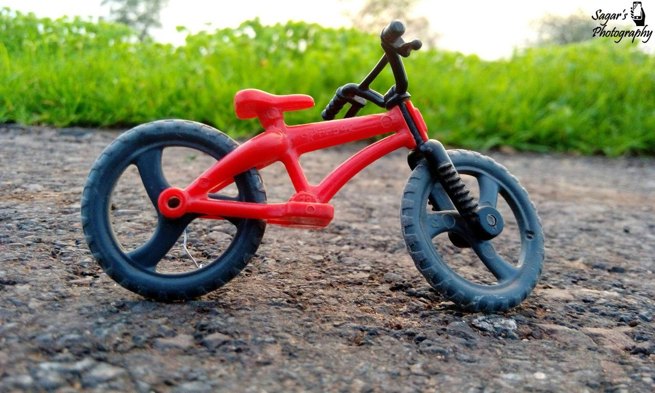 Cute little cycle Childhood Outdoors Grass Day Child Red Toyphotography Close-up People