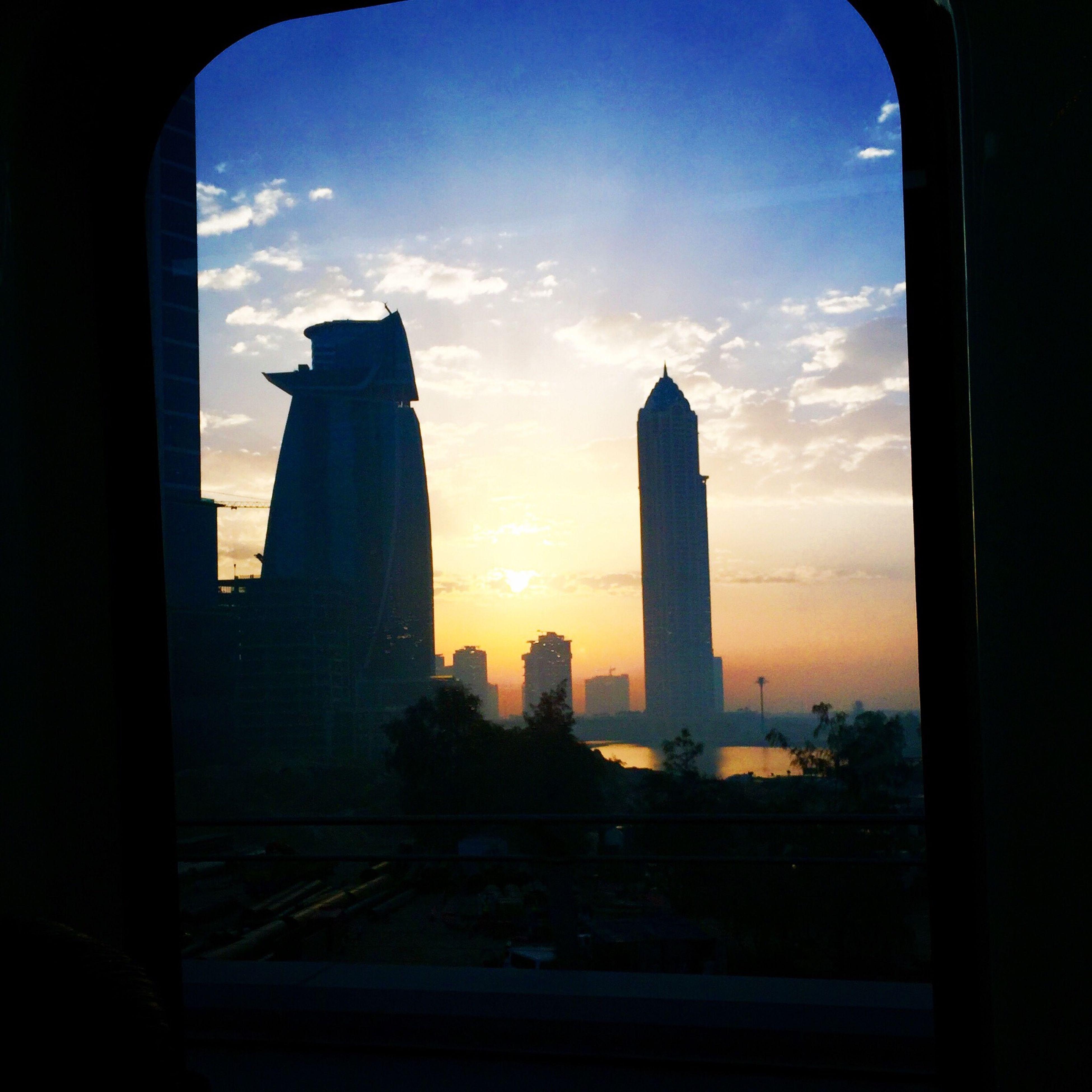 architecture, built structure, building exterior, sky, sunset, city, silhouette, skyscraper, cityscape, tower, famous place, indoors, travel destinations, cloud - sky, tall - high, capital cities, travel, international landmark, tourism, cloud