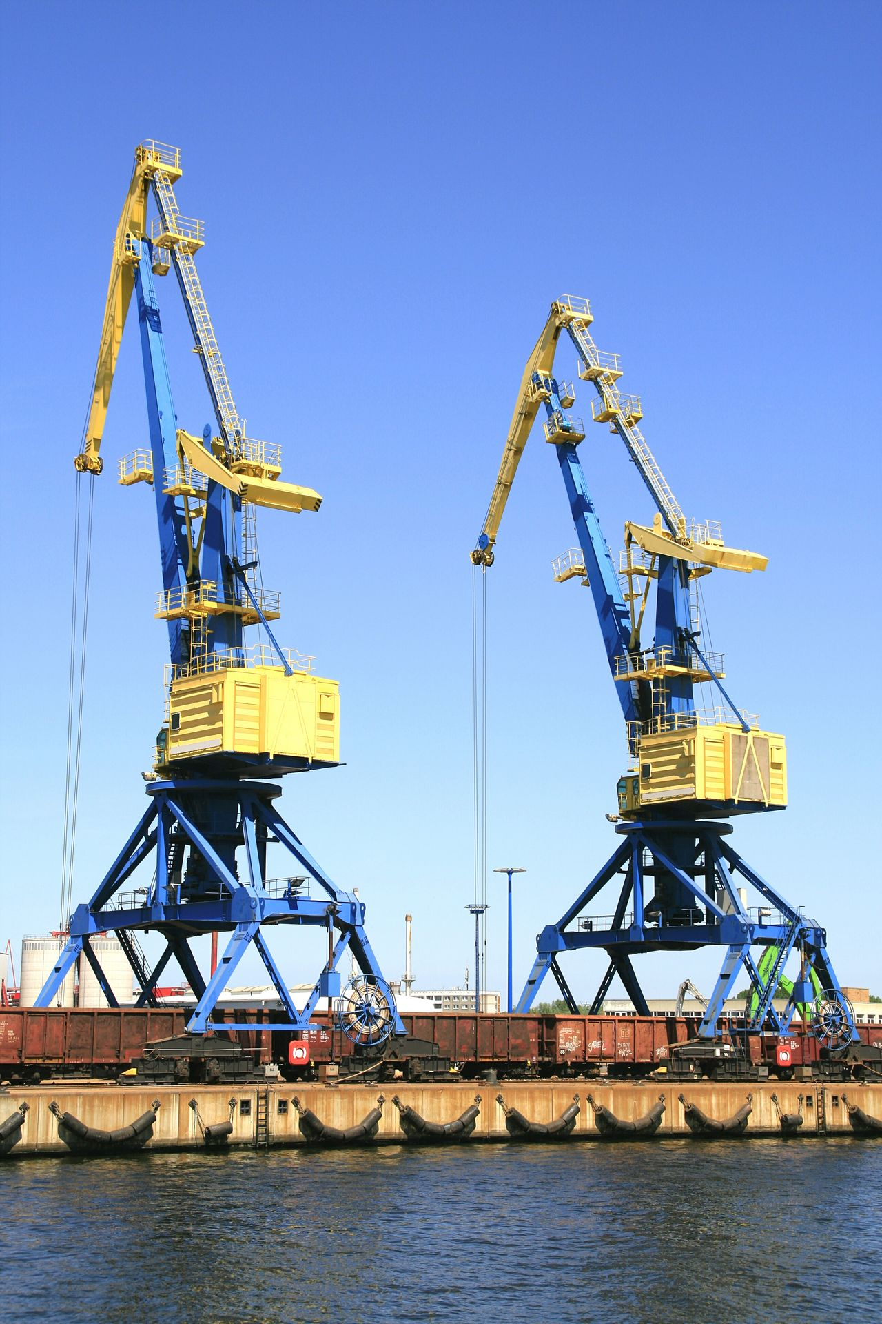Crane - Construction Machinery Waterfront Commercial Dock Sea Low Angle View Clear Sky Outdoors Harbor Crane - Construction Machinery Waterfront Water Low Angle View Clear Sky Development Commercial Dock Sea Day Blue Outdoors No People Sky Harbor Crane Crane Truck