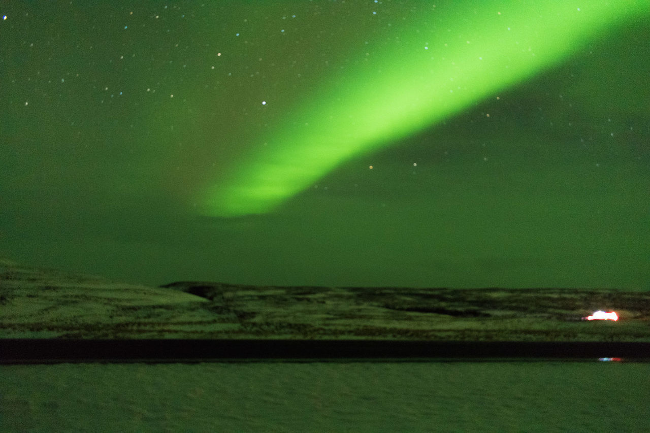 night, aurora polaris, green color, scenics, beauty in nature, illuminated, nature, tranquil scene, tranquility, no people, outdoors, star - space, sea, sky, water, astronomy, space