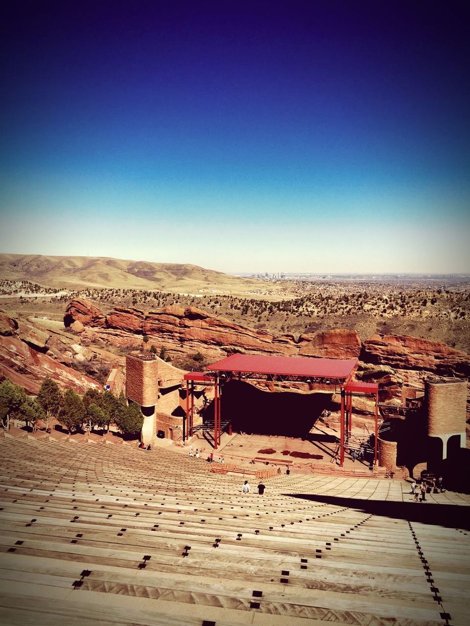 IPSLeadingLines IPhoneography Redrocksamphitheatre Denver,CO 645proMkIII Red Rocks amphitheater overlooking the city of Denver, seen in the background.