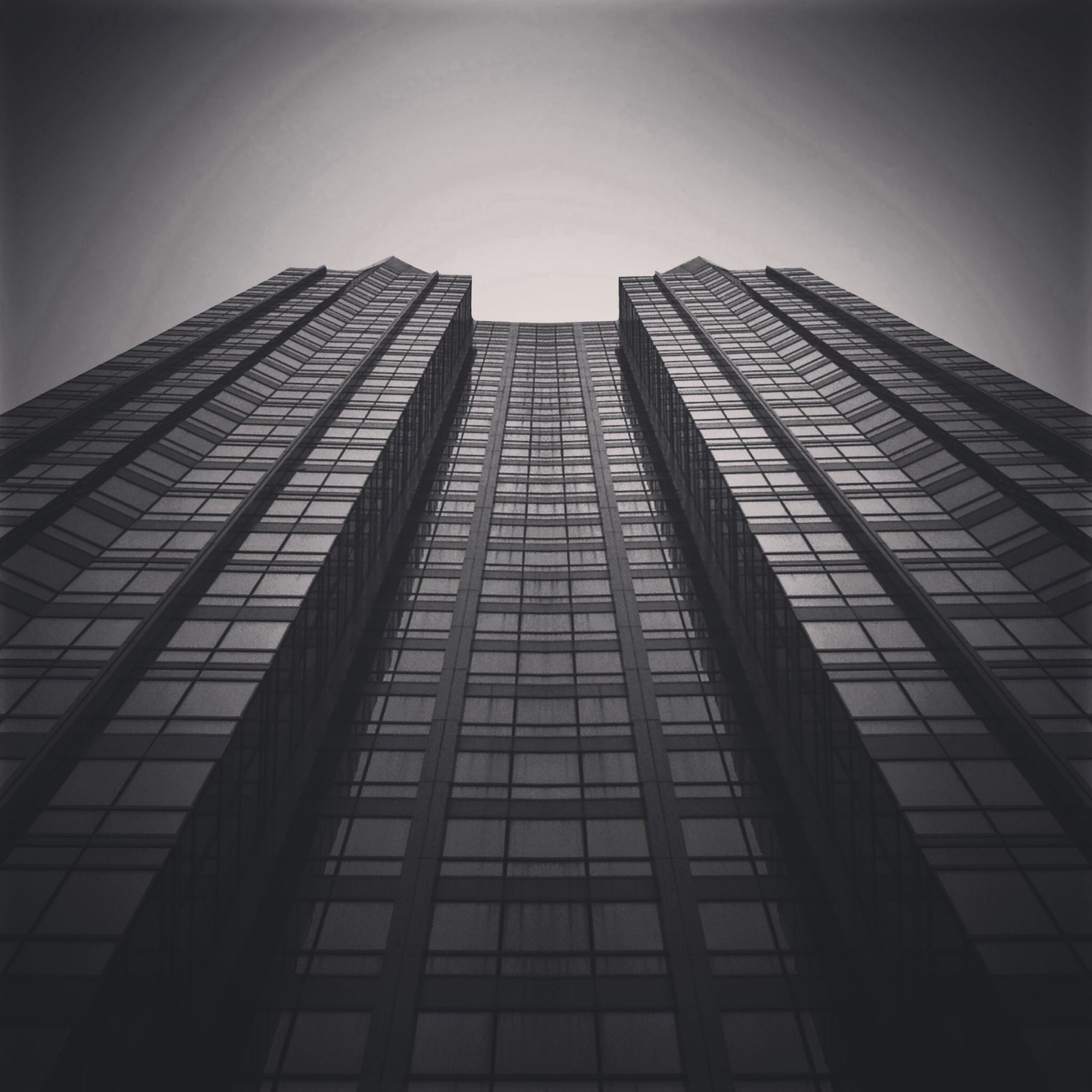 architecture, building exterior, built structure, low angle view, office building, modern, city, skyscraper, tall - high, building, glass - material, tower, sky, clear sky, window, reflection, day, no people, outdoors, tall