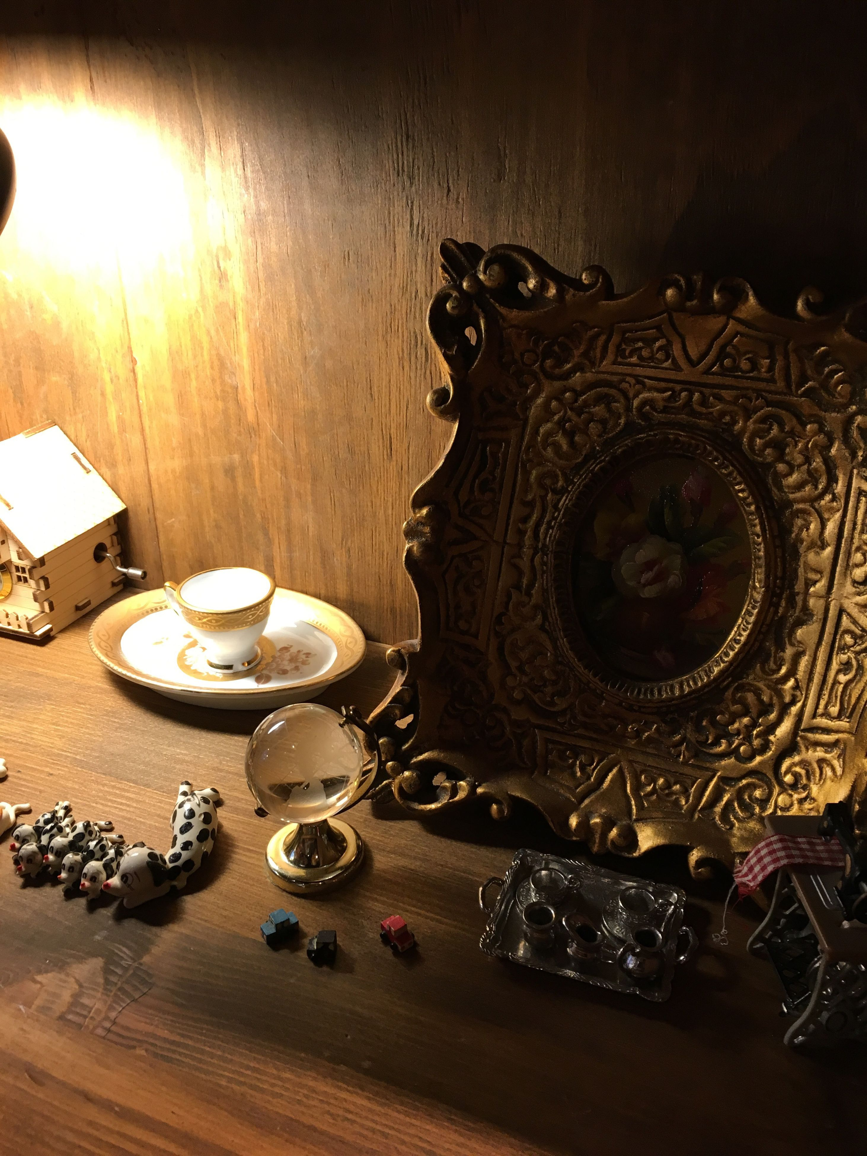 indoors, table, illuminated, still life, high angle view, old-fashioned, home interior, lighting equipment, antique, retro styled, no people, technology, arts culture and entertainment, close-up, large group of objects, luxury, wall - building feature, music, arrangement, in a row