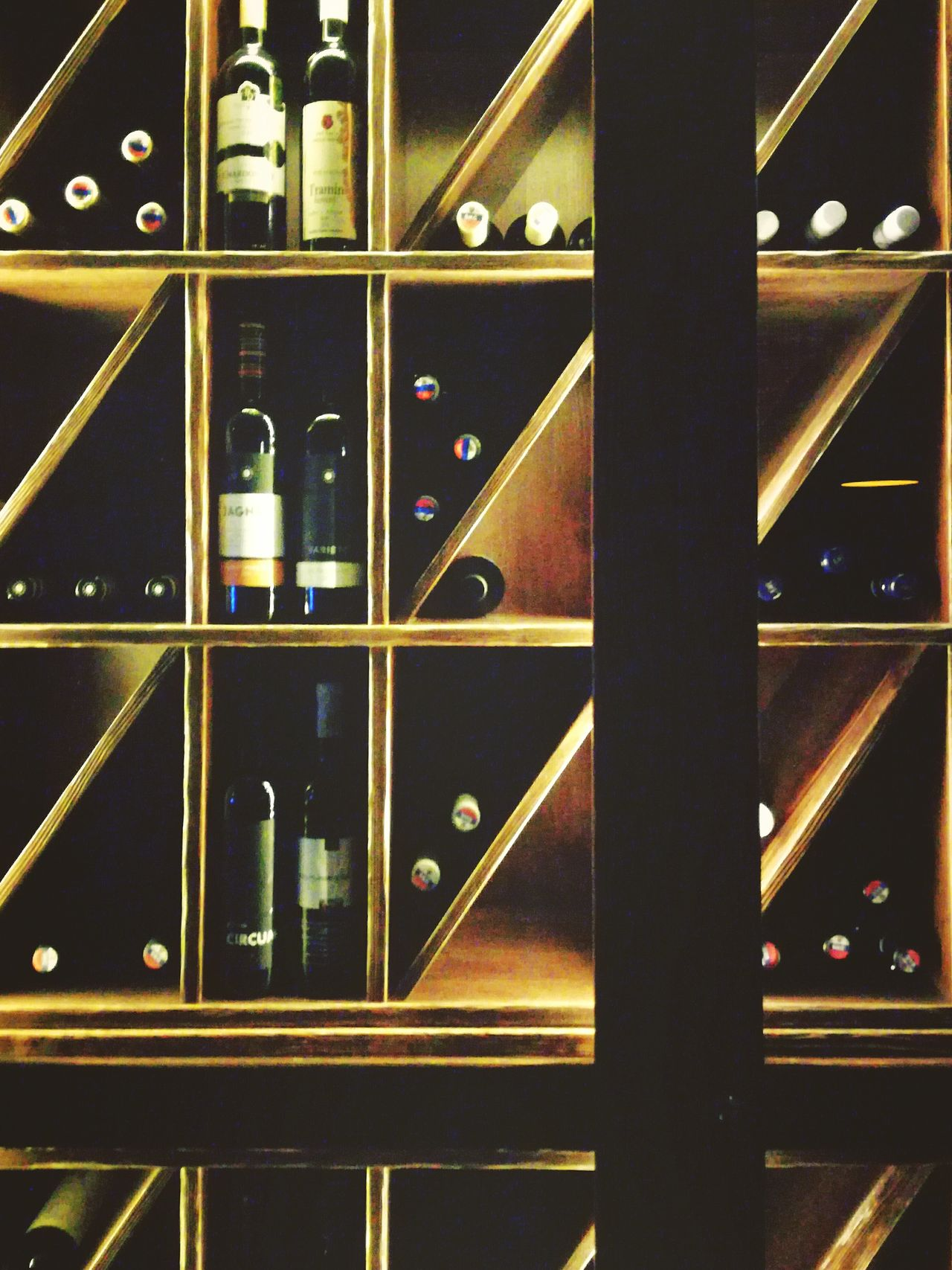 Metal No People Indoors  Backgrounds Wine Wine Bottle Wine Time Wine Tasting Winelover Wine? Oh! Winelovers  Wines Wineandmore Winetasting Wine Bottles Wine Rack Shelf Intimate Light Source Intimate Shadow Wood - Material Wooden