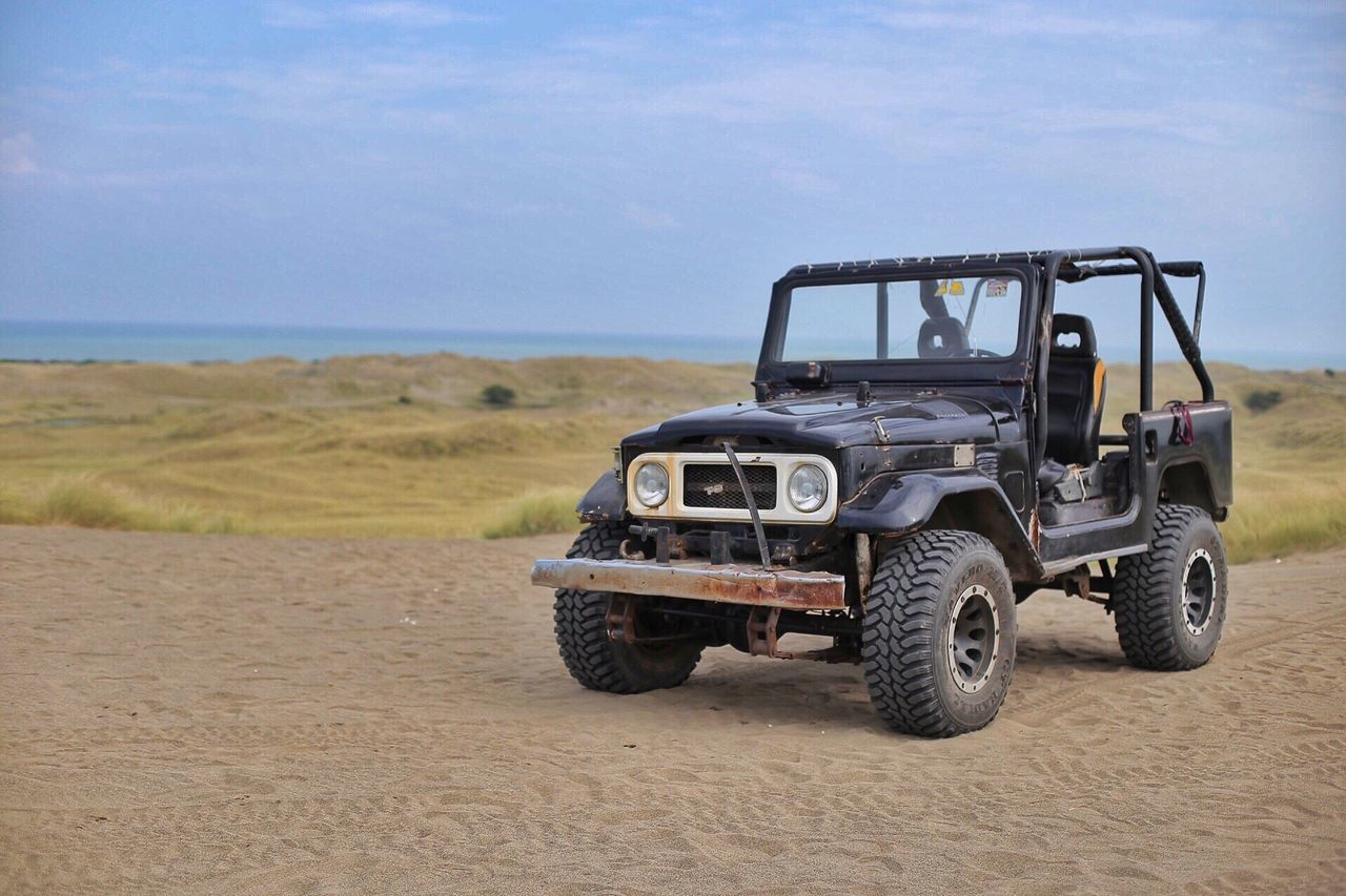 sky, land vehicle, landscape, off-road vehicle, day, nature, no people, sea, outdoors