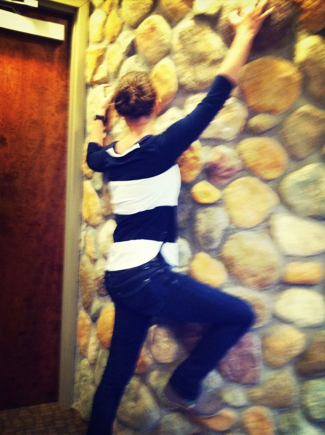 Trying to climb the wall