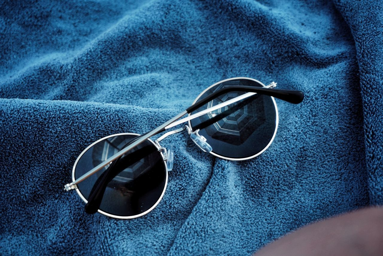 sunglasses, eyeglasses, human body part, close-up, day, one person, indoors, one man only, people, human hand, only men