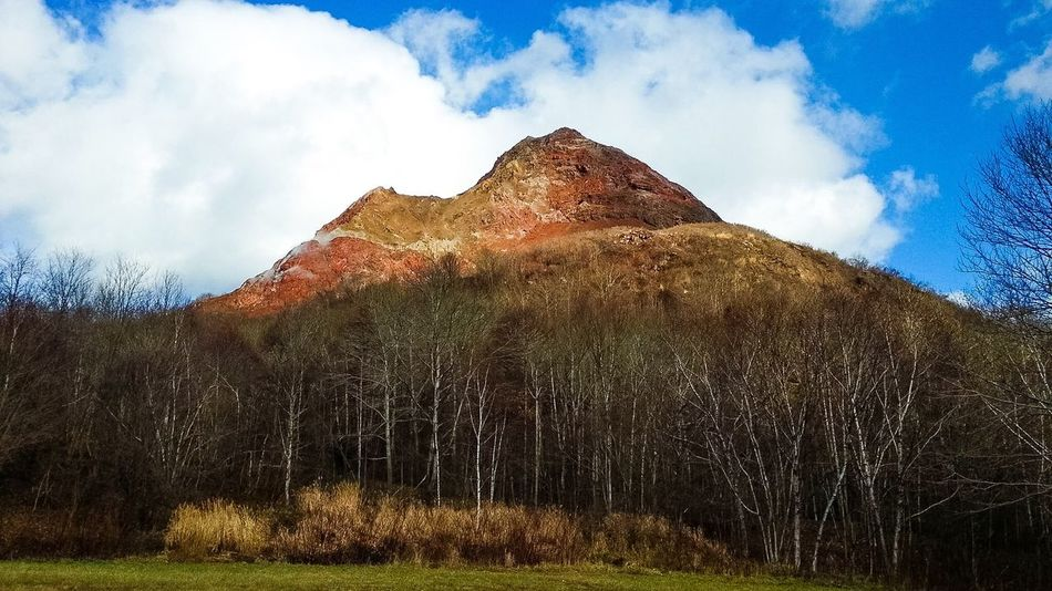 [Showa-Shinzan] (Mountain Showa) Volcanic lava dome in the Shikotsu-Toya National Park, Hakkaido, Japan. Mountain Landscape Travel Destinations Beauty In Nature Tree Nature Sky Tourism Cloud - Sky Mountain Range