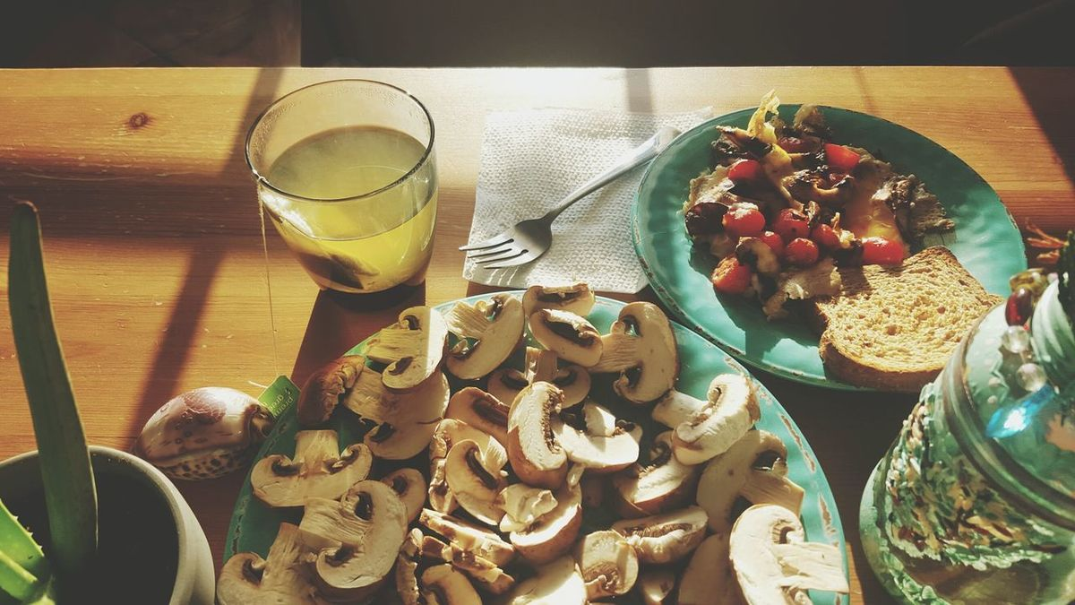 Breakfast with cooked eggs, portobello mushrooms, grape tomatoes and green tea. Fresh ideas for breakfast. Healthy nutritional food. Food And Drink Table Drinking Glass High Angle View Drink Indoors  Healthy Eating Freshness Plate Food Day Fruit Sunlight Close-up Ready-to-eat Eggs Vegetables Green Tea Mushrooms Grape Tomatoes Healthy Lifestyle Nutritional Supplement Breakfast Superfood Nutrients