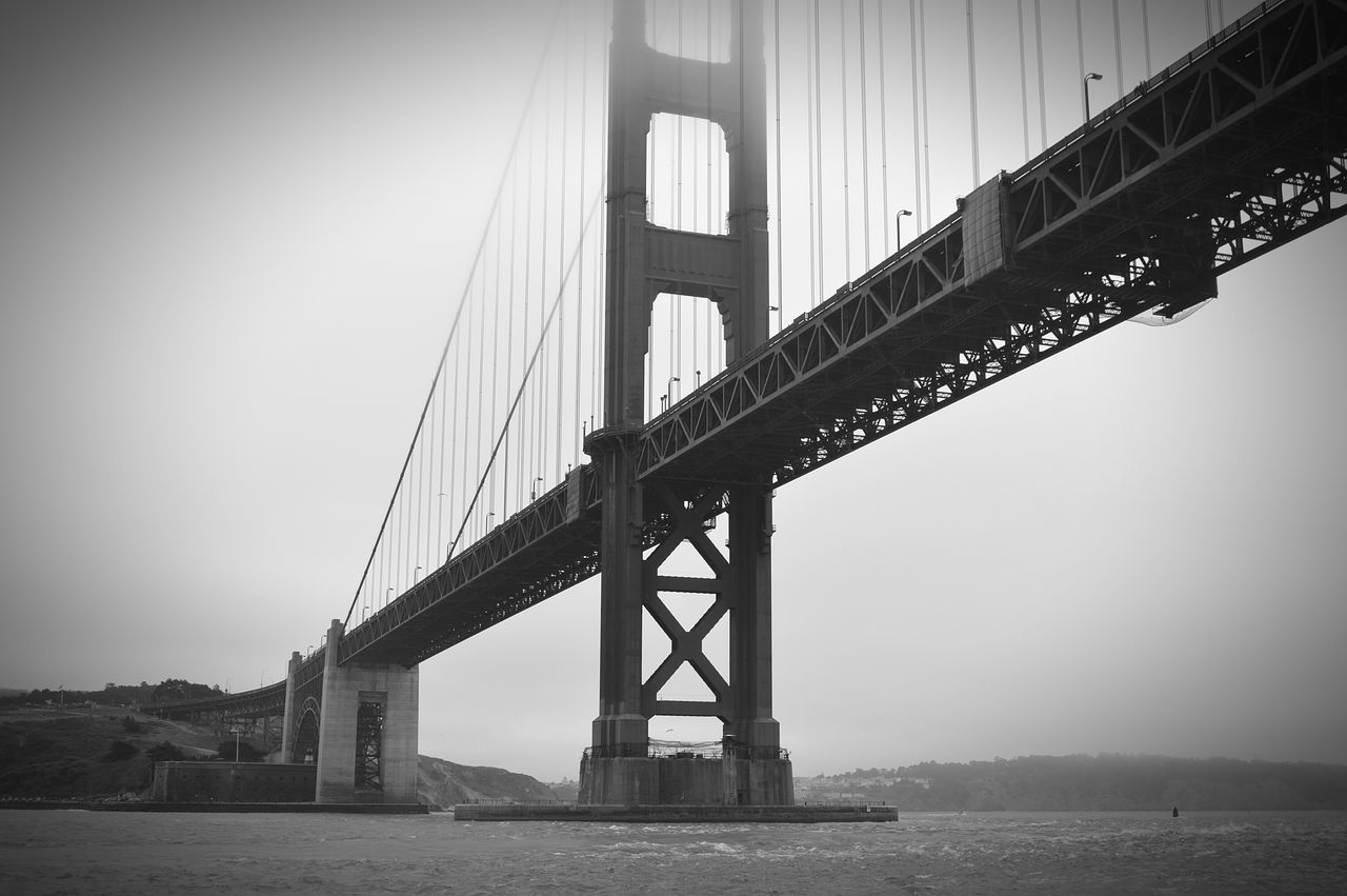 Bridge - Man Made Structure Travel Destinations Travel Water Sky Built Structure Tourism No People Suspension Bridge Outdoors Low Angle View Architecture Cloudy Ocean View San Francisco Bay Bridge California Dreaming California Love Blackandwhite
