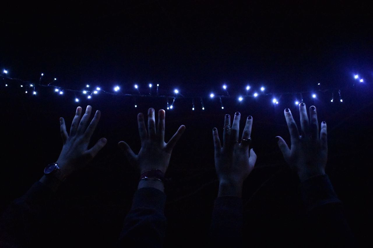 human hand, night, real people, illuminated, human body part, men, celebration, enjoyment, lifestyles, togetherness, nightlife, blue, arts culture and entertainment, leisure activity, indoors, large group of people, youth culture, women, excitement, crowd, close-up, people