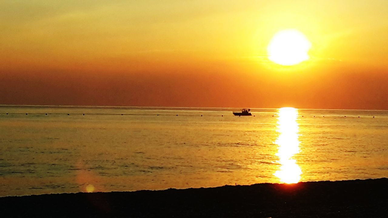sunset, sun, sea, nature, beauty in nature, scenics, orange color, water, silhouette, horizon over water, tranquil scene, reflection, tranquility, sunlight, sky, idyllic, nautical vessel, outdoors, transportation, mode of transport, yellow, no people, beach, jet boat