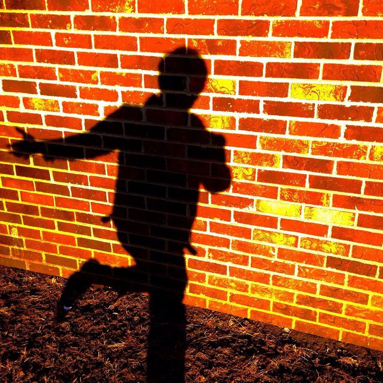 Chasing Shadows Brick Wall Sunlight One Person Outdoors Day Sunset Sunlight Sillouette Shadows Shadow Sillouettes And Shadows Sillouettes In Motion EyeEmNewHere EyeEmNewHere