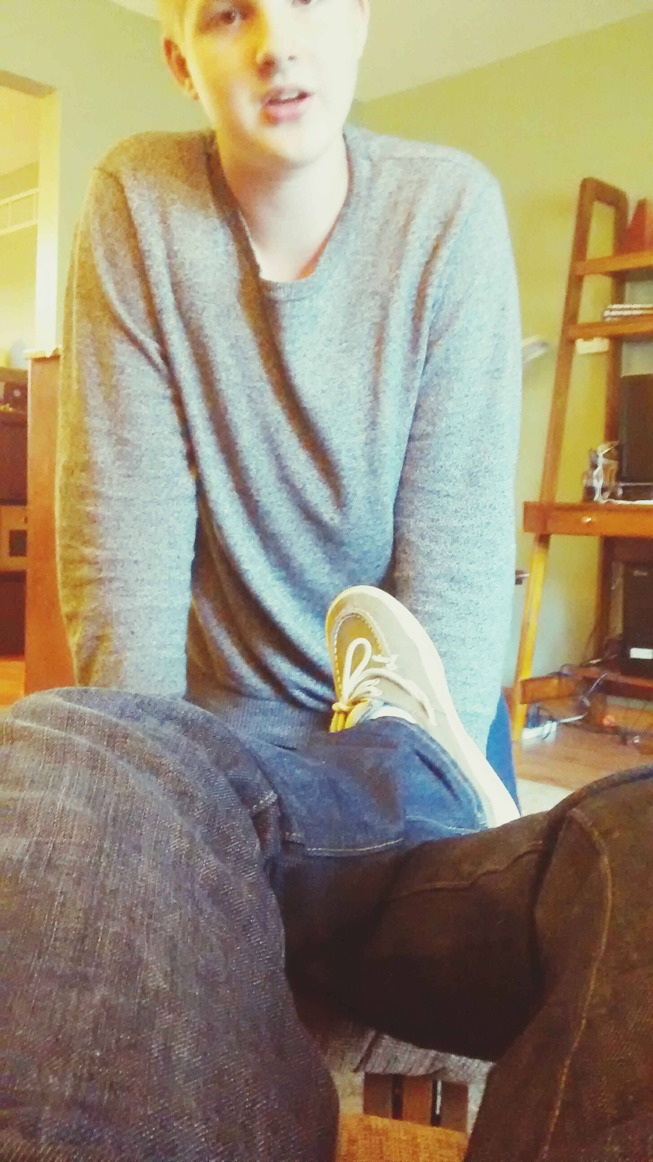 casual clothing, indoors, lifestyles, person, three quarter length, front view, leisure activity, sitting, standing, young adult, home interior, jeans, full length, childhood, jacket, waist up, young men, side view