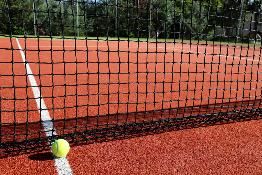 Ball Clay Close-up Competition Court Day Leisure Activity Net - Sports Equipment No People Outdoors Racket Sport Sport Sports Equipment Sunlight Tennis Tennis Ball Tennis Net Tennis Racket