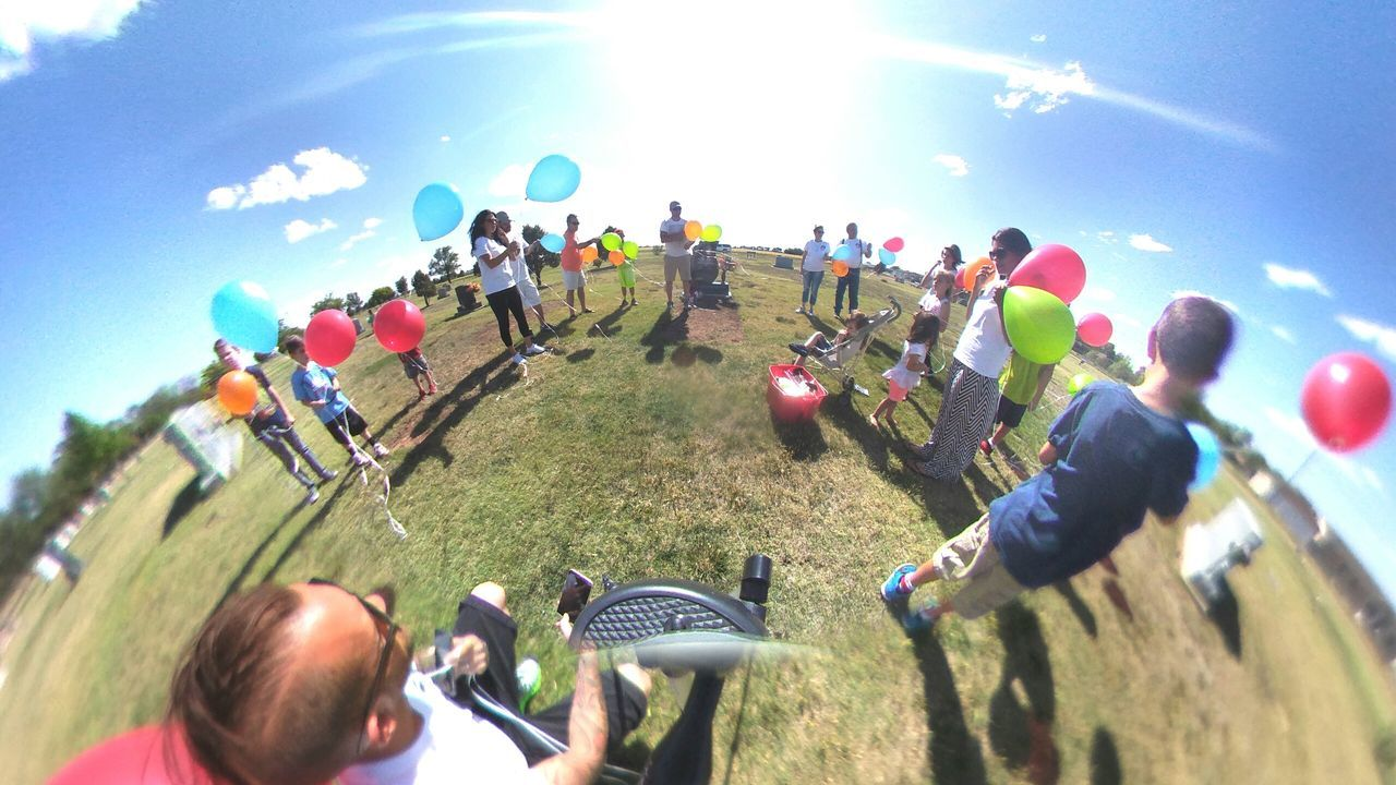large group of people, real people, sunlight, men, leisure activity, day, togetherness, outdoors, lifestyles, field, women, playing, sky, grass, crowd, nature, competition, people