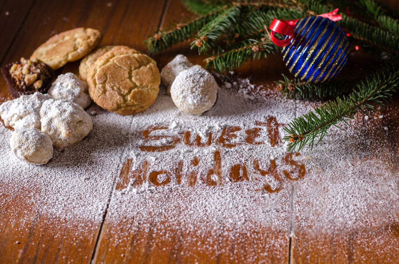 sweet treats with sweet holidays written in powdered sugar Baking Time Holiday Home Cooking Mexican Wedding Cookies Seasonal Food Sugar Calories Celebration Christmas Close-up Cookie Day Decorations For Xmas Evergreen Branches Food Food Photography Freshness Home Made Sweets  Indoors  No People Powdered Sugar Sweet Food Sweet Foods EyeEm Ready   Food Stories