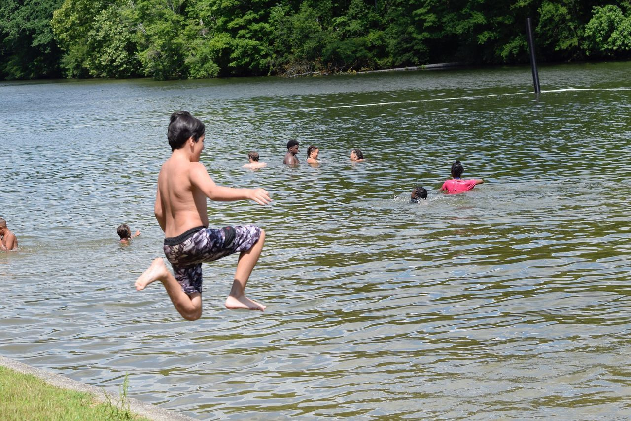 Shirtless Water Lake Day Togetherness Swimming Outdoors Childhood Nature Vacations Leisure Activity High Angle View Fun Boys Full Length Real People Two People Child People Tree Jumping Live For The Story